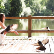 Smiling sit with doves — Stock Photo