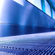 Blue moving escalator in the office hall — Stock Photo #1330366