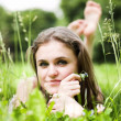 Girl lays on grass — Stock Photo #1330523