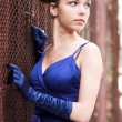 Beautiful girl in blue with gloves — Stock Photo