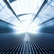 Moving escalator in the office hall — Stock Photo #1330748