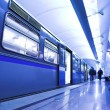 Blue fast train stay at platform — 图库照片