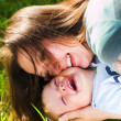 Mother and baby boy embrace — Stock Photo #1331024