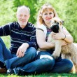 Terrier dog and family - Stock Photo