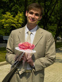 Man with the bouquet — Stock Photo