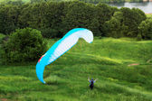 Colorful extreme paraglide on grass — Stock Photo