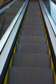Metro metal escalator staircase — Stock Photo