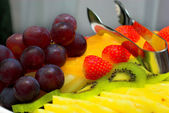 Fruits on the plate — Stock Photo