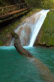 Waterfall and big beam — Stock Photo