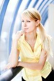 Girl in yellow in blue corridor — Stock Photo