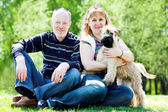 Terrier dog and family — Stock Photo