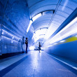 Train on platform in subway — Stockfoto
