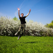 Active jumping man - Stock Photo