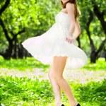 Smile girl dance in white dress — Stock Photo