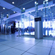 Blue gates in airport terminal — Stock Photo