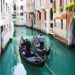 Stock Photo: Gondoliers on water