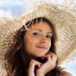 Smiling girl in hat — Stock fotografie
