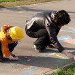 Sisters draw on asphalt — Foto de Stock
