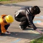 Sisters draw on asphalt — Stock Photo