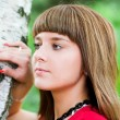Dreaming girl near birch — Stock Photo