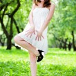Smile girl dance in white dress — Stock Photo #1380883