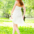 Girl back in white dress — Stock Photo