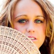 Stock Photo: Smiling beautiful girl with fan