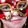 Woman in red mask on carnaval - Stock Photo