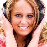Smiling girl in headphones — Stock Photo #1381104
