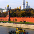 Kremlin wall and blue Moskva river - Stock Photo