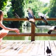 Smiling sit with doves — Stockfoto