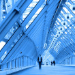Blue glass corridor in bridge — Stock Photo #1381178