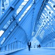 Blue glass corridor in bridge — Stock Photo