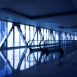 Glass corridor with escalator — Stockfoto