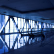 Glass corridor with escalator - Stock Photo