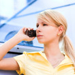 Lady in yellow talk by phone — Stock Photo