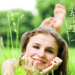 Girl lays on grass — Stock Photo #1381737