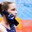 Royalty-Free Stock Photo: Teenager girl in blue talk by phone