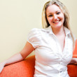 Woman in white sit on armchair — Stock Photo