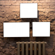 Three empty frames and radiator — Stock Photo