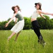 Stock Photo: Two jumping girls on blue sky