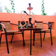 Hookah on table and chairs — Stock Photo