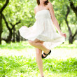 Smile girl dance in white dress — Stock Photo