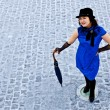 Oriental girl stay with umbrella on road - Stock Photo