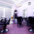 Armchairs in hairdressing salon - Stok fotoğraf