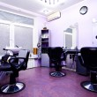 Armchairs in hairdressing salon - Stock Photo