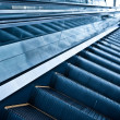 Royalty-Free Stock Photo: Moving up escalator