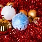 Tinsel and christmas balls — Stock Photo