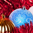 Red tiinsel and christmas balls - Foto Stock