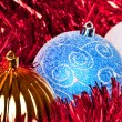 Red tiinsel and christmas balls - Stockfoto